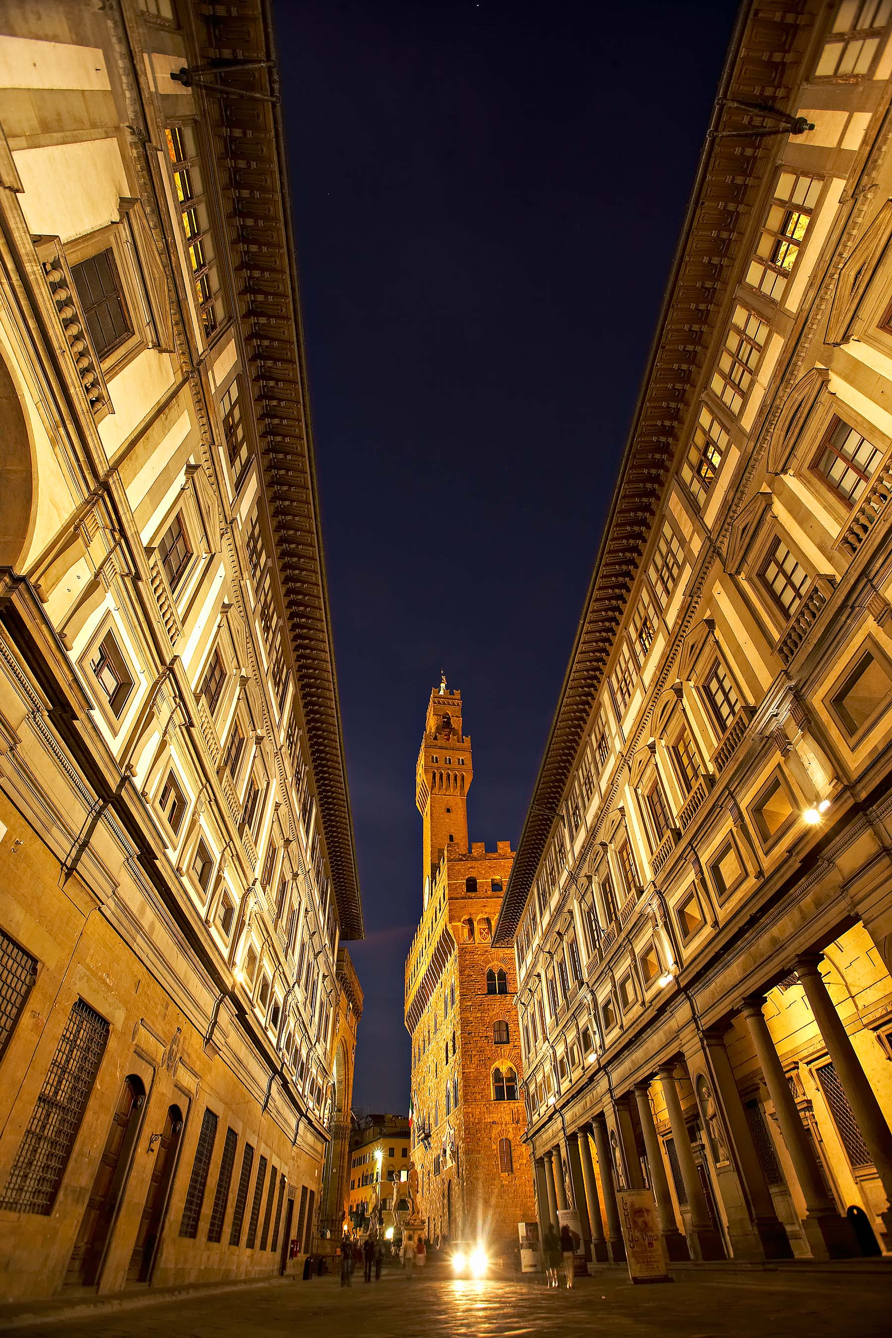 Florence, Italy - Palazzo Vechio at dusk framed by the Ufizzi Gallery